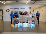 BCS Staff and Brooklyn Police with donated school supplies