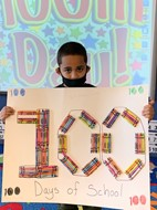 First Grader Holding 100th Day of School Poster during 2020-21 School Year
