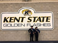 Nina and Alex in front of KSU sign