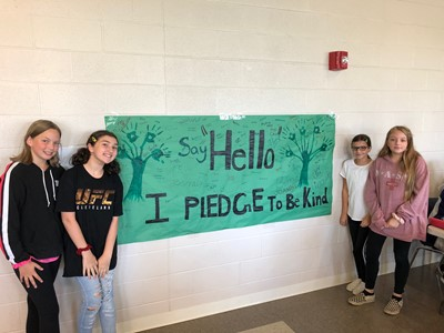 Students in front of Pledge to Be Kind Banner